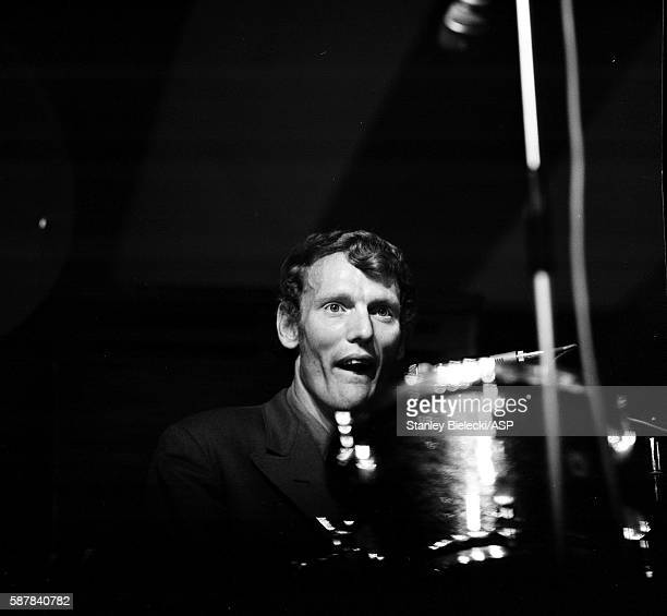 Ginger Baker performs on stage with the Graham Bond Organisation at the National Jazz and Blues Festival, Richmond, United Kingdom, 7th August 1965.