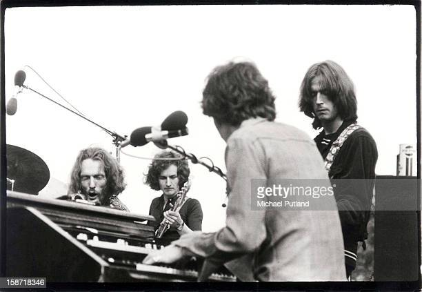 Ginger Baker, Rick Grech, Steve Winwood and Eric Clapton of Blind Faith perform on stage in Hyde Park, London, 7th June 1969.