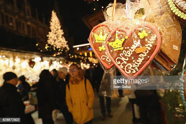 """Ginger bread heart with sugar coating that reads: """"Little Princess"""" hangs for sale a stall at the annual Christmas Market at Marienplatz square on..."""