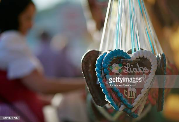 Ginger bread hearts for sale hang from a stall during day 7 of Oktoberfest beer festival on September 28 2012 in Munich Germany This year's edition...