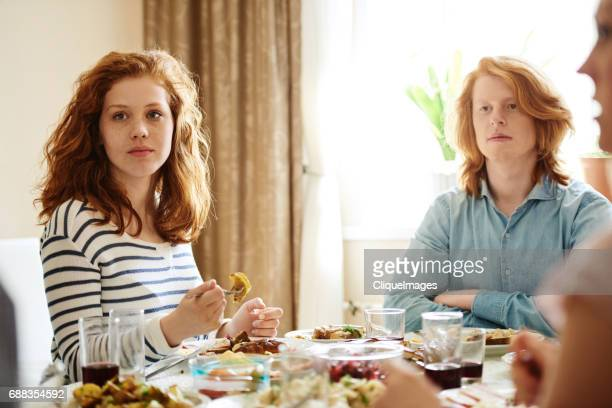 ginger brother and sister on family dinner - cliqueimages stockfoto's en -beelden
