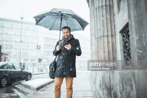 Ginger businessman outdoors on a snowy day