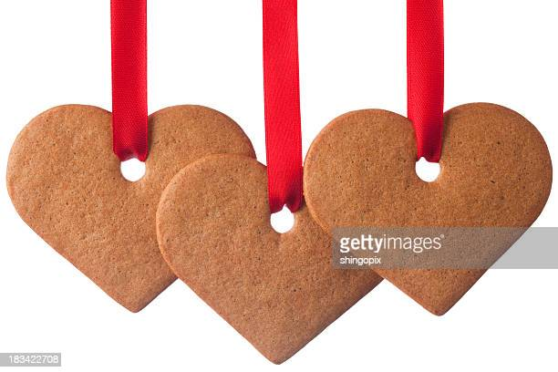 Ginger cookie heart ornaments on white background