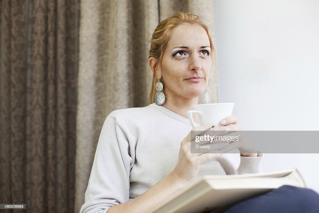 Ginger girl with cup of coffee : Stock Photo