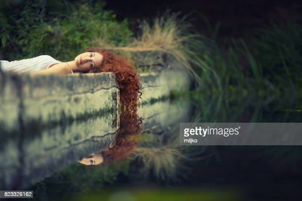ginger hair beauty in nature - lake auburn stock photos and pictures
