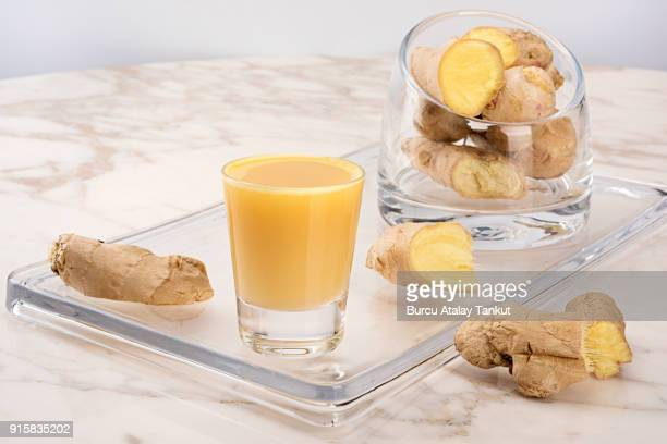 ginger juice - ginger stock photos and pictures