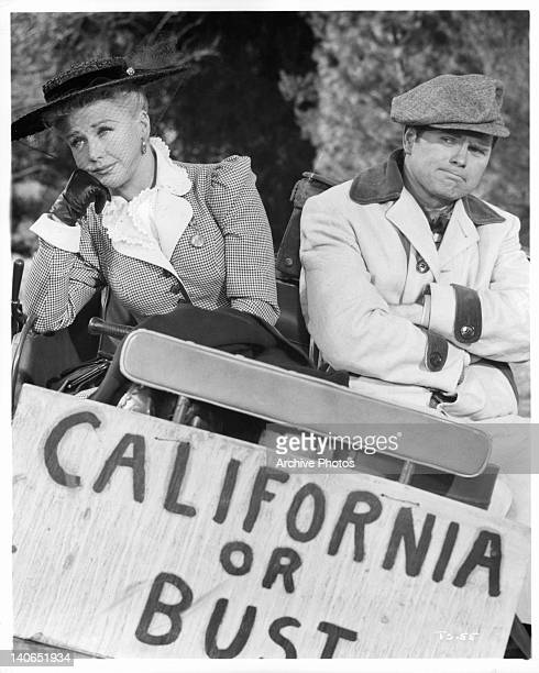 Ginger Rogers and Barry Nelson with California Or Bust sign in a scene from the film 'The First Traveling Saleslady', 1956.