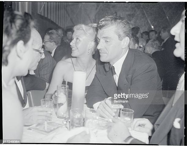 Ginger Rogers and Greg Bautzer popular Hollywood attorney at the Mocambo in Hollywood The two have been a constant twosome since Ginger's divorce...
