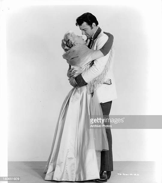 Ginger Rogers and James Arness embrace in a scene from the film 'The First Traveling Saleslady' 1956