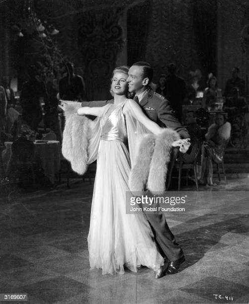 Ginger Rogers as Irene Foote Castle and Fred Astaire as Vernon Castle dancing together in the RKO film 'The Story of Vernon and Irene Castle'...