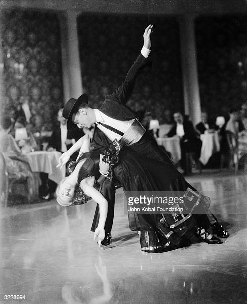 Ginger Rogers as Penelope 'Penny' Carroll and Fred Astaire as John 'Lucky' Garnett dancing together in the RKO film 'Swing Time' directed by George...