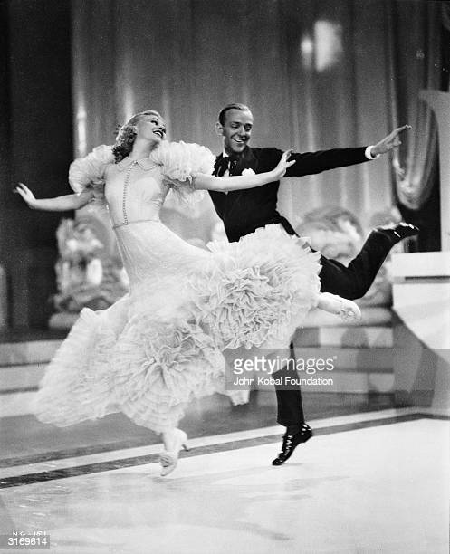 Ginger Rogers as Penny Carroll and Fred Astaire as John 'Lucky' Garnett dancing together in the RKO film 'Swing Time' directed by George Stevens with...