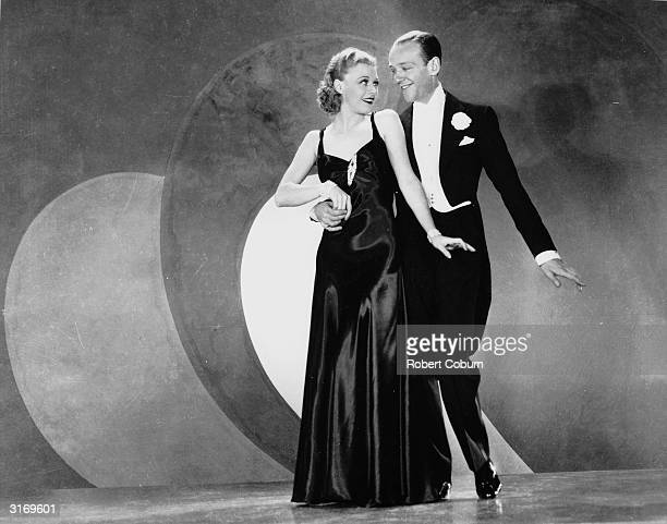 Ginger Rogers as Scharwenka aka Lizzie Gatz and Fred Astaire as Huckleberry Haines dancing together in the RKO film' Roberta' Director William A...