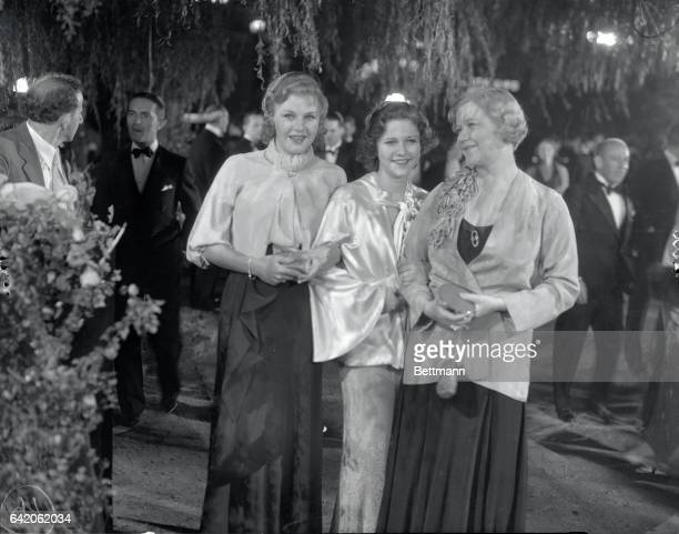 Ginger Rogers popular musical comedy and screen star with Phyllis Fraser and Ginger's mother Mrs Rogers as they appeared at the recent opening of the...