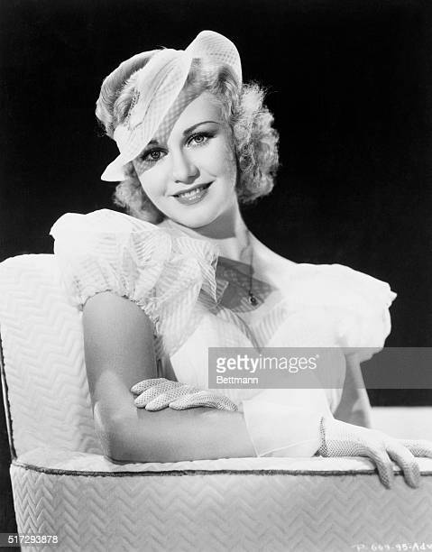 Ginger Rogers vivacious RKO player wears a lovely bouffant evening gown of yellow striped mousseline It is backless and features the inevitable full...