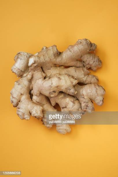 ginger root closeup bright yellow background
