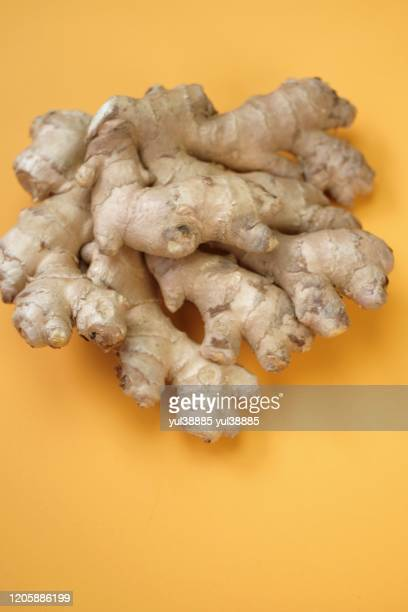ginger root closeup yellow background organic