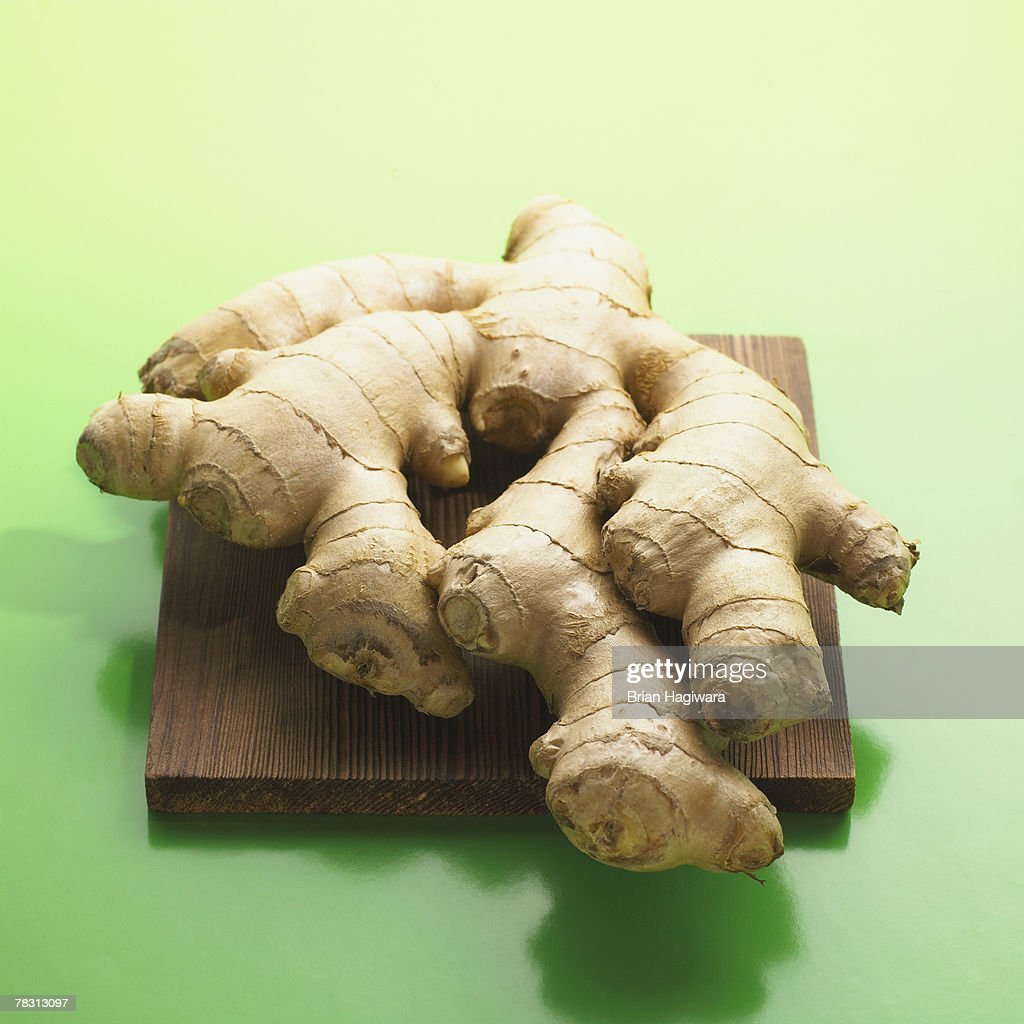 Ginger root on cutting board : Stock Photo