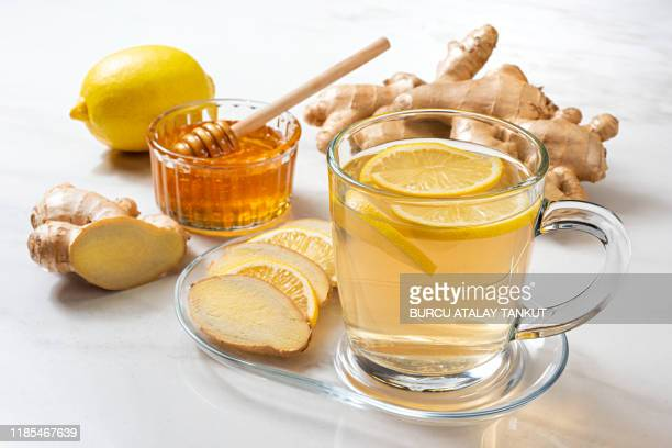 ginger tea with lemon and honey - ginger spice stock pictures, royalty-free photos & images