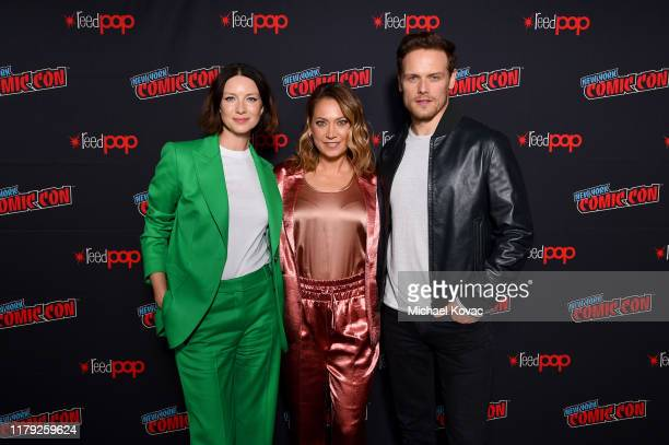 """Ginger Zee, Caitriona Balfe and Sam Heughan attend STARZ """"Outlander"""" at NYCC 2019 on October 05, 2019 in New York City."""