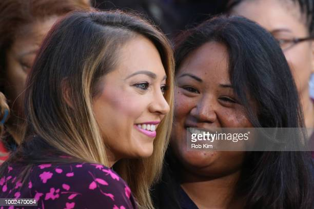 Ginger Zee of ABC's 'Good Morning America' poses with a fan at SummerStage at Rumsey Playfield Central Park on July 20 2018 in New York City