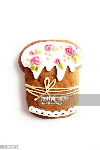 gingerbread cookie in the shape of easter cake isolated on white background - easter cake stock pictures, royalty-free photos & images