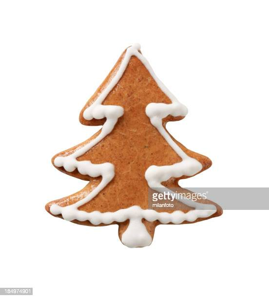 Gingerbread cookie shaped like Christmas tree with icing