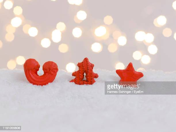 gingerbread cookies on fake snow - fake snow stock pictures, royalty-free photos & images