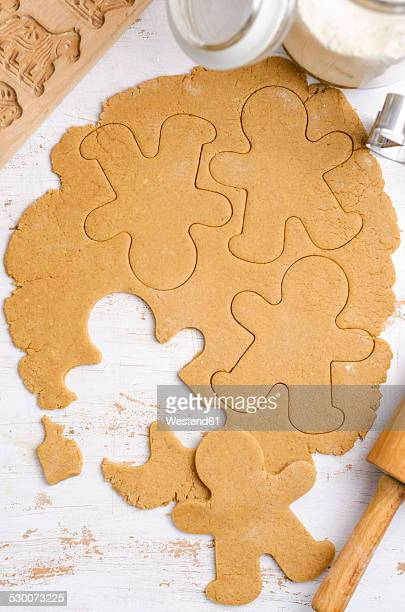 Gingerbread dough with gingerbread man cookie cutter