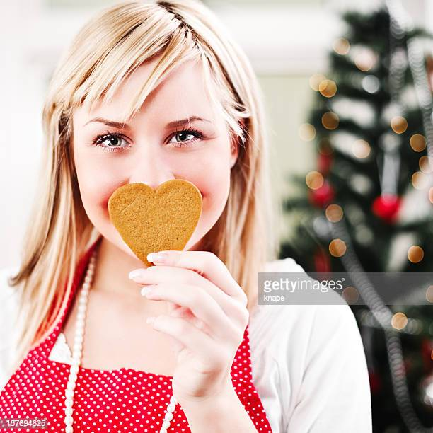 Gingerbread heart cookie and swedish woman ready for christmas