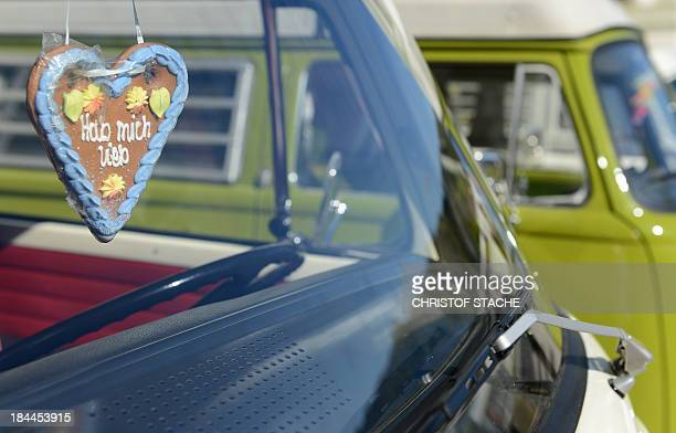 A gingerbread heart hangs in the front window of a Volkswagen VW bus during an autumn rally of socalled 'Bulli' enthousiasts in front of the abbey...