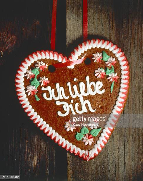 Gingerbread heart infront of wood bread