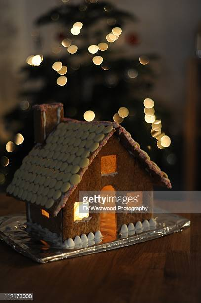 Gingerbread house and christmas tree background