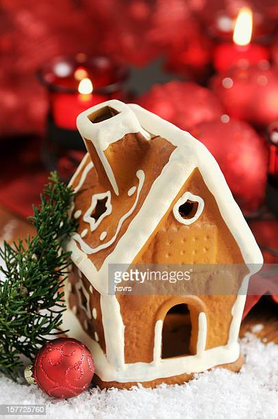 Gingerbread house with candle and Christmas ornaments