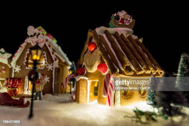 Gingerbread Houses During Christmas Against Black Background