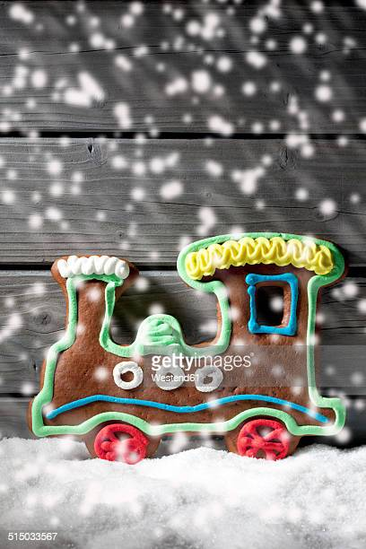 Gingerbread locomotive with rippling artificial snow in front