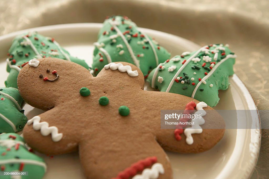 Gingerbread man and Christmas cookies on plate, elevated view : Stock Photo