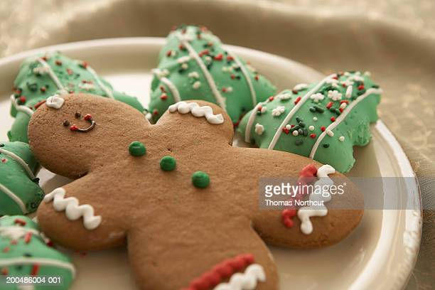 gingerbread man and christmas cookies on plate, elevated view - gingerbread man stock photos and pictures