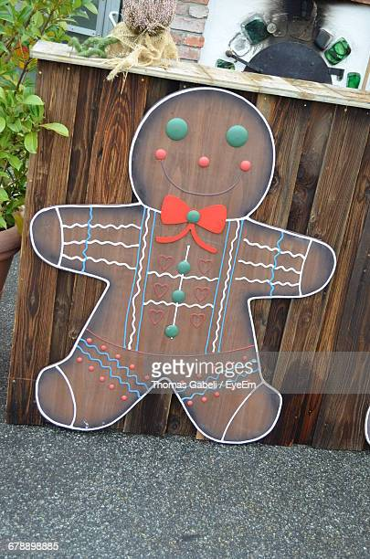 gingerbread man by wooden structure in yard - brown thomas christmas stock pictures, royalty-free photos & images