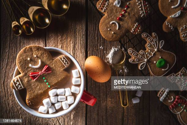 gingerbread man christmas cookie inside hot chocolate mug - gingerbread men stock pictures, royalty-free photos & images