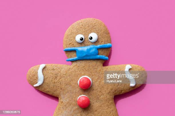 gingerbread man christmas cookie wearing protective face mask - funny christmas stock pictures, royalty-free photos & images