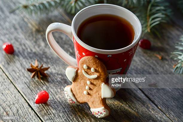 Gingerbread man cookie and cup of tea