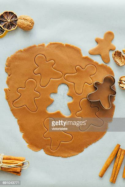 Gingerbread man cookie cutter with gingerbread dough