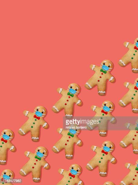 gingerbread man cookies with surgical mask - gingerbread men stock pictures, royalty-free photos & images