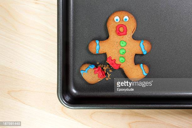 A gingerbread man looking shocked with a broken leg