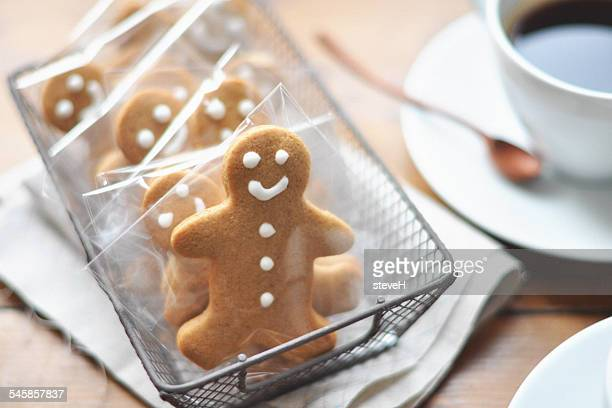 Gingerbread men in a row and coffee on table