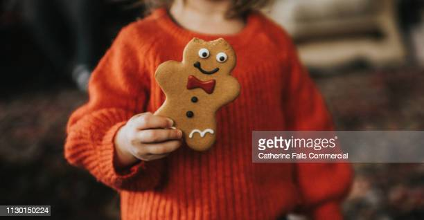 gingerbread men - gingerbread men stock pictures, royalty-free photos & images