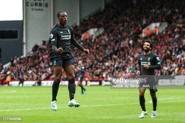 Gini Wijnaldum of Liverpool celebrates after scoring a goal to make it 0-1 during the Premier League match between Sheffield United and Liverpool FC...