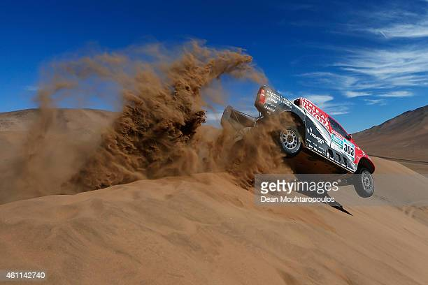 Giniel De Villiers of South Africa and Dirk Von Zitzewitz of Germany for Toyota Imperial Team South Africa in the Pick Up Hilux compete during day 4...