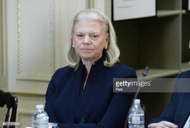 Ginni Rometty CEO IBM listens as US President Donald Trump speaks during a strategic and policy discussion with CEOs in the State Department Library...